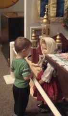 Grandson was fascinated by doll.