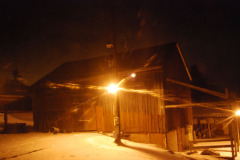 Barn in winter evening