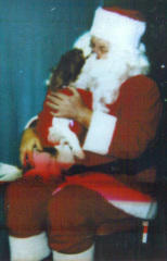 Briney kisses Santa Claus