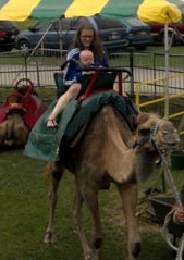 Ayden and sissy Coda riding a camel