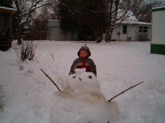 Connor making a snowman