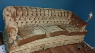 ugly metalic gold couch