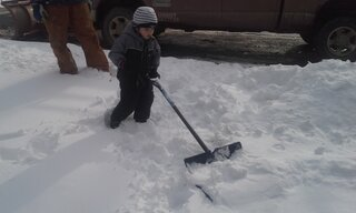 our 3yr old son helping dad shovel