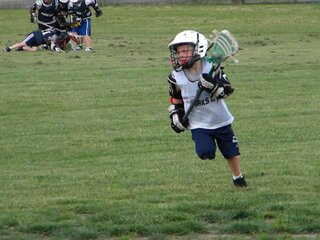 Zander dominating in lax...CF U-8 team