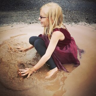 My darling niece playing in a puddle