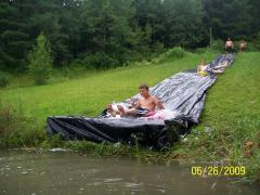80ft long slip-n-slide into pond