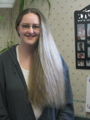 young woman donates to Locks of Love