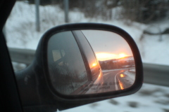 Sunrise in the rearview mirror