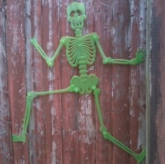 Halloween skeleton running from snow.