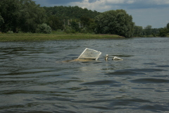 Abandoned Powerboat Adds to River Trash