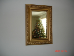 Christmas tree reflection in mirror