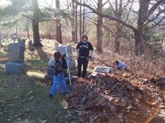 Scouts from troop 180 clean-up cemetary
