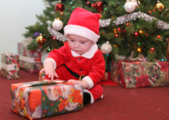 Little Santa Helper Placing A Gift