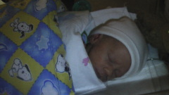 Alexander In the NICU with a Blanket from the 8th graders