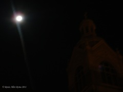 Church bell tower by moon light