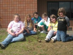 Girl Scout Troop 37 Planting a tree