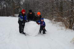 IT TAKES 4 PEOPLE TO MOVE THIS HEAVY SNOWBALL IN TUESDAYS STORM